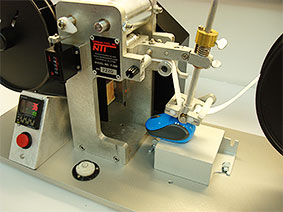 RCA Abrasion Wear Tester testing computer mouse
